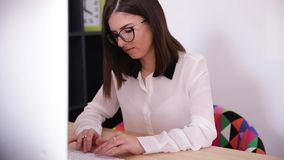 Businesswoman typing on the keyboard stock video