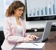 Businesswoman typing on laptop Royalty Free Stock Image