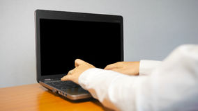 Businesswoman Typing On a Laptop Computer With an Alpha Screen. stock video footage