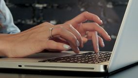 Businesswoman typing on laptop computer. Professional shot on BMCC with high dynamic range. You can use it e.g in your commercial video, business or office stock footage