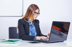 Businesswoman typing on laptop Stock Photography