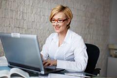 Businesswoman typing on laptop Stock Photo