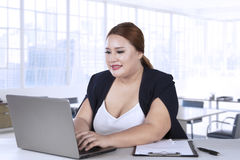 Businesswoman typing on laptop in office Royalty Free Stock Photo