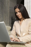 Businesswoman typing laptop Stock Images