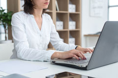 Businesswoman typing on laptop at workplace Woman working in office hand keyboard Stock Photography