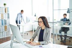 Businesswoman typing Stock Photos