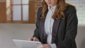 Businesswoman typing and scrolling tablet screen, online shopping, hectic life. Stock footage stock video