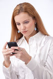 Businesswoman typing on smartphone Stock Images