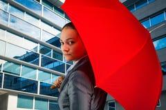 Businesswoman with umbrella Stock Photos