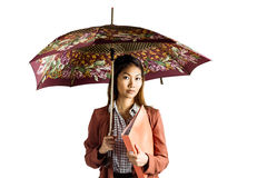 Businesswoman with an umbrella holding a binder. On white background Royalty Free Stock Photo