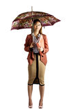 Businesswoman with an umbrella holding a binder Stock Photo