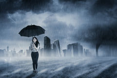 Businesswoman with umbrella standing in rain Royalty Free Stock Photos
