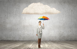 Businesswoman with umbrella Stock Image
