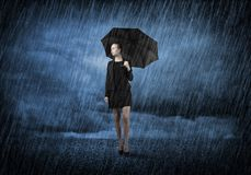 Businesswoman with umbrella Royalty Free Stock Images
