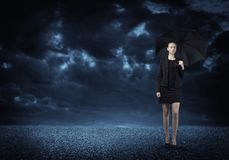 Businesswoman with umbrella Stock Images