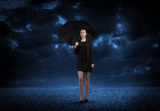 Businesswoman with umbrella Royalty Free Stock Photo
