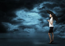 Businesswoman with umbrella Royalty Free Stock Photography