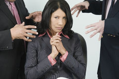 Businesswoman under attack Royalty Free Stock Photography