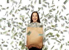 Businesswoman under dollar's rain Royalty Free Stock Photos