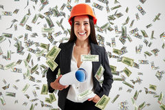 Businesswoman under dollars rain Royalty Free Stock Images