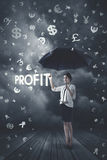 Businesswoman under money rain royalty free stock image