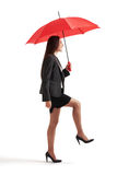 Businesswoman under red umbrella Royalty Free Stock Photo