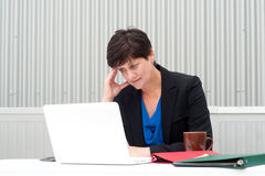 Businesswoman under stress, fatigue, and headache Royalty Free Stock Photos