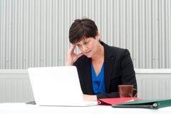 Businesswoman under stress, fatigue, and headache Royalty Free Stock Photos
