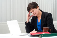 Businesswoman under stress, fatigue, and headache Royalty Free Stock Images