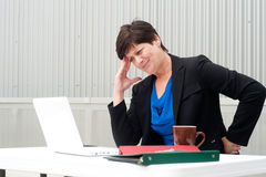 Businesswoman under stress, fatigue, and headache Stock Images