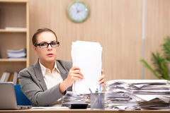 The businesswoman under stress from too much work in the office Royalty Free Stock Photo