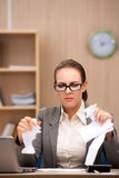 The businesswoman under stress from too much work in the office Royalty Free Stock Image