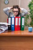 The businesswoman under stress working in the office Stock Photography