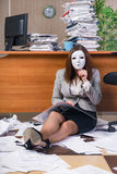 The businesswoman under stress working in the office. Businesswoman under stress working in the office Royalty Free Stock Photography