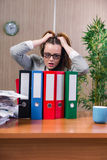 The businesswoman under stress working in the office Royalty Free Stock Photos