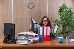 The businesswoman under stress working in the office Royalty Free Stock Photo