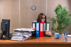 The businesswoman under stress working in the office Stock Image