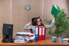 The businesswoman under stress working in the office Royalty Free Stock Photography