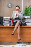 The businesswoman under stress working in the office Stock Photo