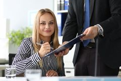 Businesswoman underwriting important documents stock photos