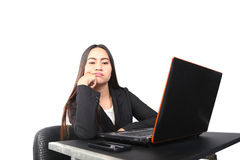 Businesswoman unhappy at her desk Royalty Free Stock Photos