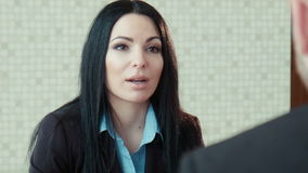 Businesswoman in a uniform talks. With client stock footage