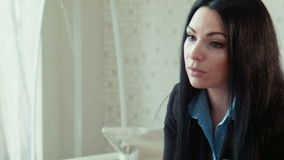 Businesswoman in a uniform talks. With client stock video footage