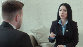 Businesswoman in a uniform talks. With client stock video