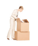 Businesswoman unpacking big boxes Stock Photography