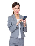 Businesswoman use of cellphone Royalty Free Stock Photography