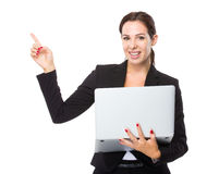 Businesswoman use of computer and finger up Stock Images