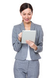 Businesswoman use of digital tablet Stock Photography