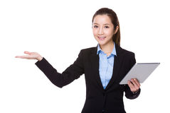 Businesswoman use digital tablet and open hand palm Royalty Free Stock Images