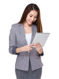 Businesswoman use of digital tablet Royalty Free Stock Images